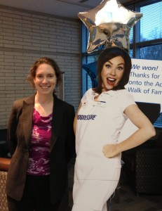 Clarissa posing with a cardboard cutout of Flo from the Progressive commercials.